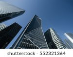 skyscrapers with glass facade.... | Shutterstock . vector #552321364