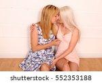 a pair of blonde same sex... | Shutterstock . vector #552353188