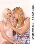a pair of blonde same sex... | Shutterstock . vector #552353308