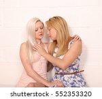 a pair of blonde same sex... | Shutterstock . vector #552353320