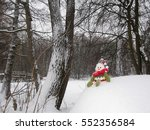 Snowman Isolated Sits On The...