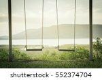 children swing in the park | Shutterstock . vector #552374704
