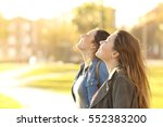 side view portrait of two happy ... | Shutterstock . vector #552383200