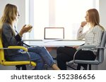 female coworkers discussing... | Shutterstock . vector #552386656