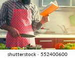 man cooking at kitchen making... | Shutterstock . vector #552400600