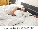 bearded man lying in bed and... | Shutterstock . vector #552401308