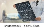 Stock photo doctor examine film x ray the brain by mri scan of the patient 552434236