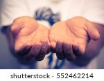 a man holding something in his...   Shutterstock . vector #552462214