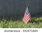 Small American Flag Placed At...