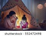 family bedtime. mom and child...   Shutterstock . vector #552472498