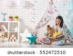 happy loving family. pretty... | Shutterstock . vector #552472510