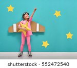 little child girl in an... | Shutterstock . vector #552472540