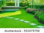 pathway in garden  green lawns... | Shutterstock . vector #552475750