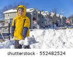 boy enjoys the snow removal....   Shutterstock . vector #552482524