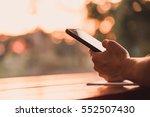 closeup of people hand using... | Shutterstock . vector #552507430