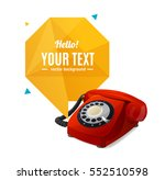 red rotary telephone with...
