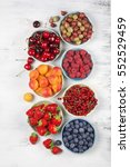 various fresh fruits in bowls... | Shutterstock . vector #552529459
