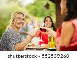 group of friends having lunch... | Shutterstock . vector #552539260