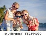 three happy children standing... | Shutterstock . vector #552544030
