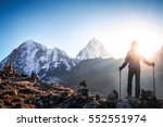 hiker with backpacks reaches... | Shutterstock . vector #552551974