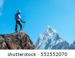 hiker with backpacks reaches... | Shutterstock . vector #552552070