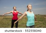 two young women doing yoga... | Shutterstock . vector #552558340