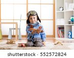 funny kid boy plays with toy... | Shutterstock . vector #552572824