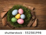 easter eggs on a wooden... | Shutterstock . vector #552581998