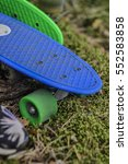 blue penny board on the grass.... | Shutterstock . vector #552583858