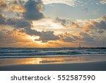 orange sunrays through clouds... | Shutterstock . vector #552587590