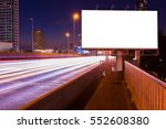 Small photo of Blank billboard on light trails, street, city and urban in the night - can advertisement for display or montage product or business.
