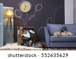 cute dog on sofa in modern room | Shutterstock . vector #552635629