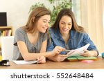 two students doing homework... | Shutterstock . vector #552648484