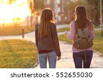 back view of two friends... | Shutterstock . vector #552655030