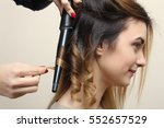 hairdresser makes hair... | Shutterstock . vector #552657529