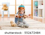 happy kid playing with toys... | Shutterstock . vector #552672484