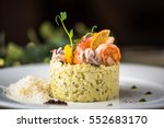 risotto with seafood. rice in... | Shutterstock . vector #552683170