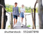 couple holding hands walking... | Shutterstock . vector #552687898