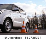 modern car and safety cones in... | Shutterstock . vector #552735334