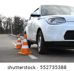 modern car and safety cones in... | Shutterstock . vector #552735388