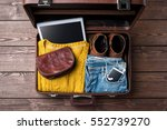 open suitcase with casual... | Shutterstock . vector #552739270
