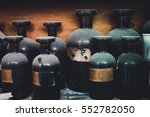 Small photo of vintage closeup image of still life composition,dusty chemical bottle on wooden rack.selective focus shot