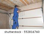 Contractor Installing Garage...