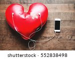 red broken heart with bandage... | Shutterstock . vector #552838498