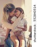 mother holding her daughter in... | Shutterstock . vector #552840514