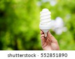 Hand Holding Light Bulb On...