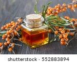 seabuckthorn oil bottle with... | Shutterstock . vector #552883894