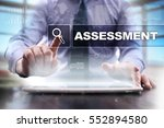 Small photo of Businessman using tablet pc and selecting assessment.