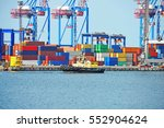 tugboat and crane in harbor... | Shutterstock . vector #552904624