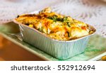 Small photo of Lasagne ready meal in foil container on the table